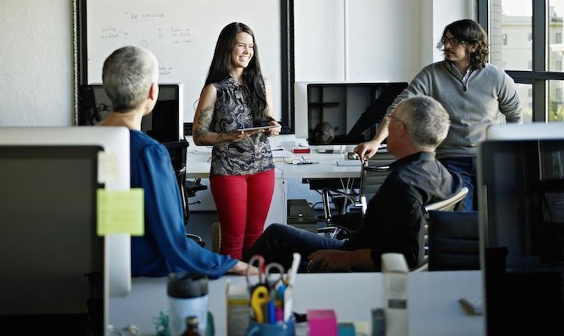 Businesswoman using digital tablet to present idea